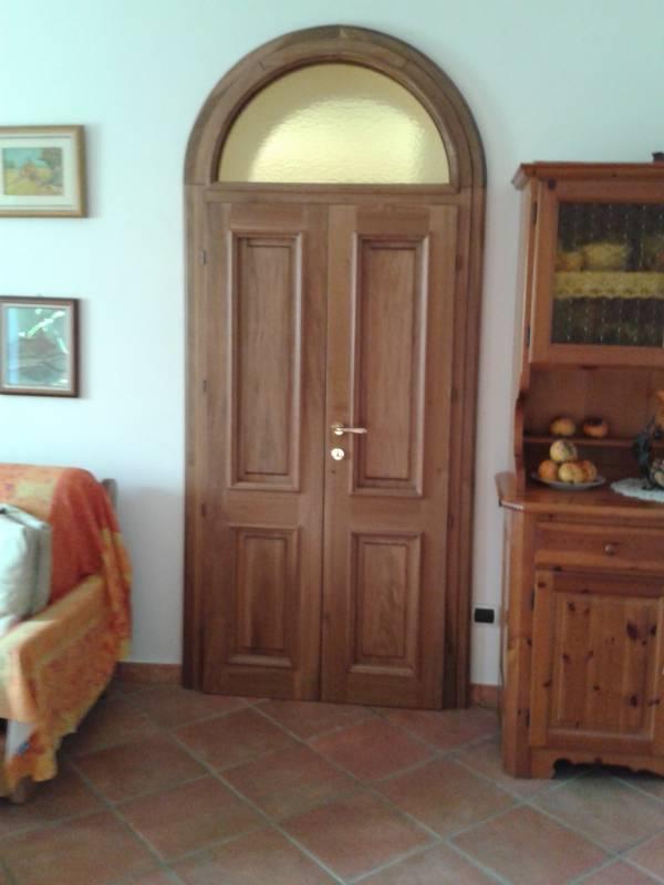 Porte interne in massello artigianali a milano - Creo Casa Milano